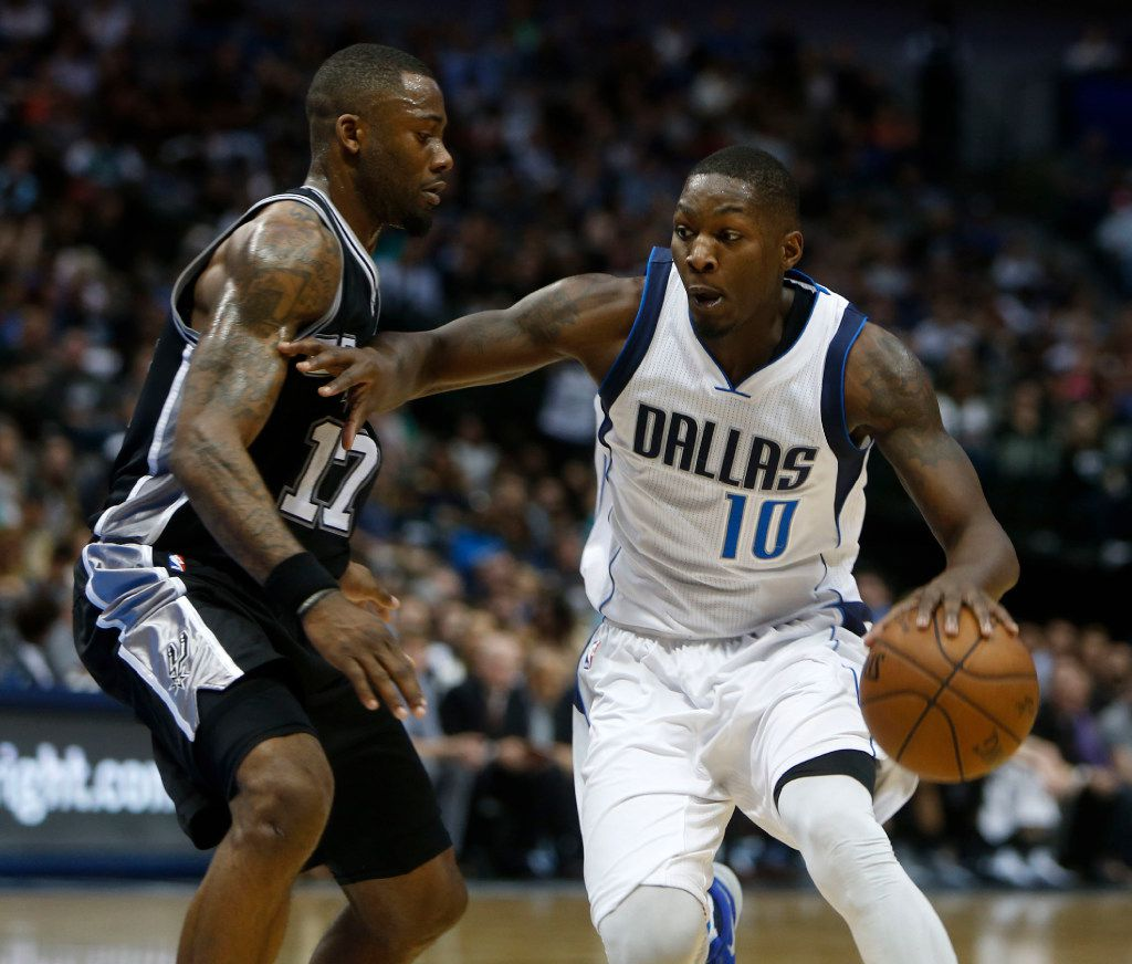 Dallas Mavericks forward Dorian Finney-Smith (10) moves the ball past San Antonio Spurs guard Jonathon Simmons (17) in the third period at the American Airlines Center in Dallas on Friday, April 7, 2017. The Dallas Mavericks lost to the San Antonio Spurs 102-89. (Rose Baca/The Dallas Morning News)