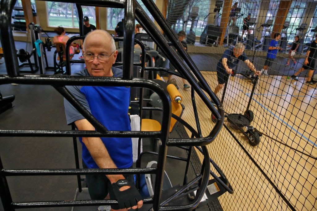 Dennis Greaney works out on the TrueStretch machine at Cooper Aerobics Center in Dallas on May 18, 2017.  (Nathan Hunsinger/The Dallas Morning News)