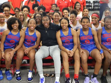 Former Duncanville star Ariel Atkins, now a WNBA champion with the Washington Mystics, poses for a photo with players in the Duncanville girls basketball program on Oct. 17, 2019 at the Duncanville ISD athletic office.