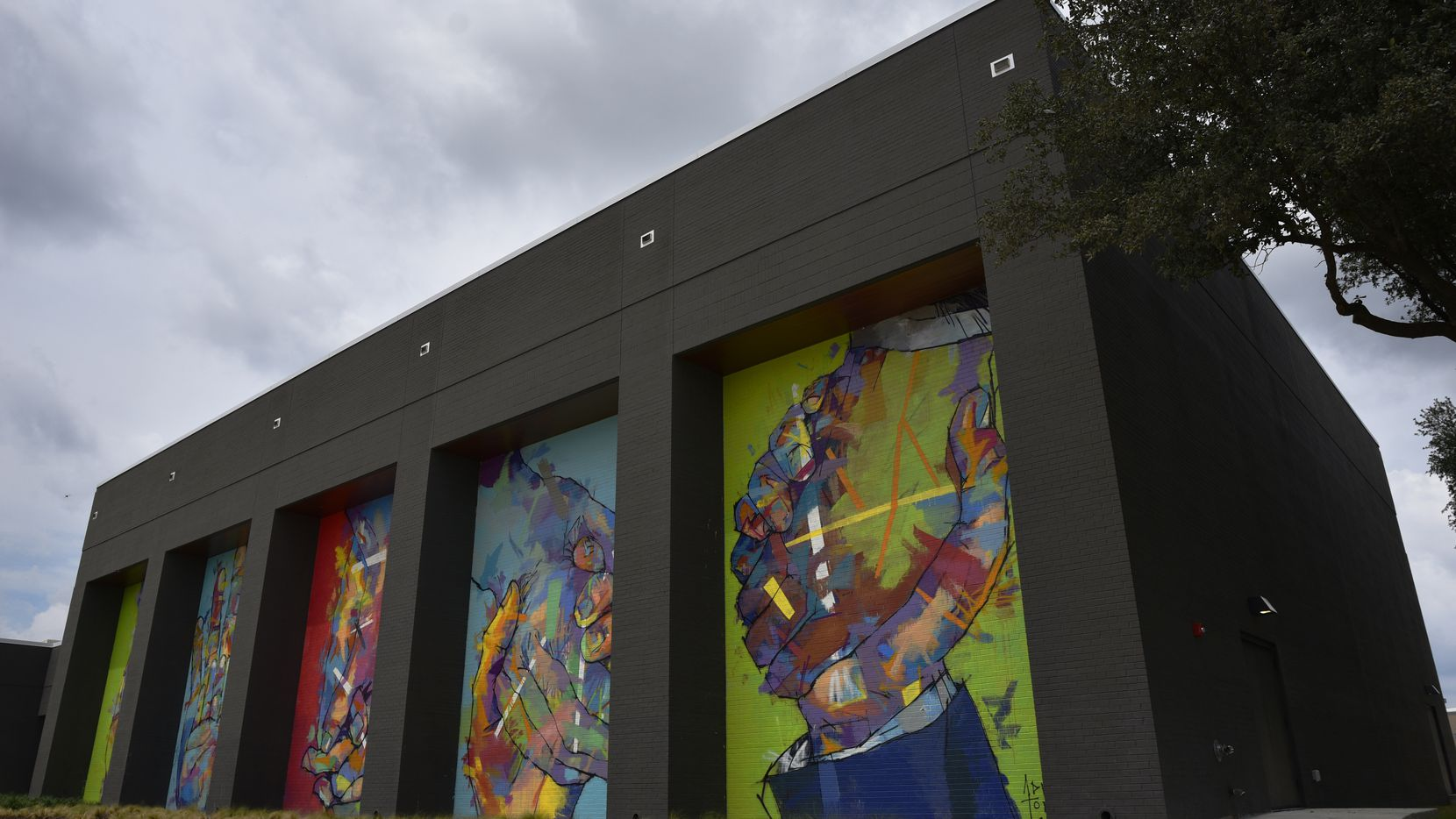 Murals by Spanish artist Adrian Torres decorate the fitness center on the campus of Legacy Central in Plano.