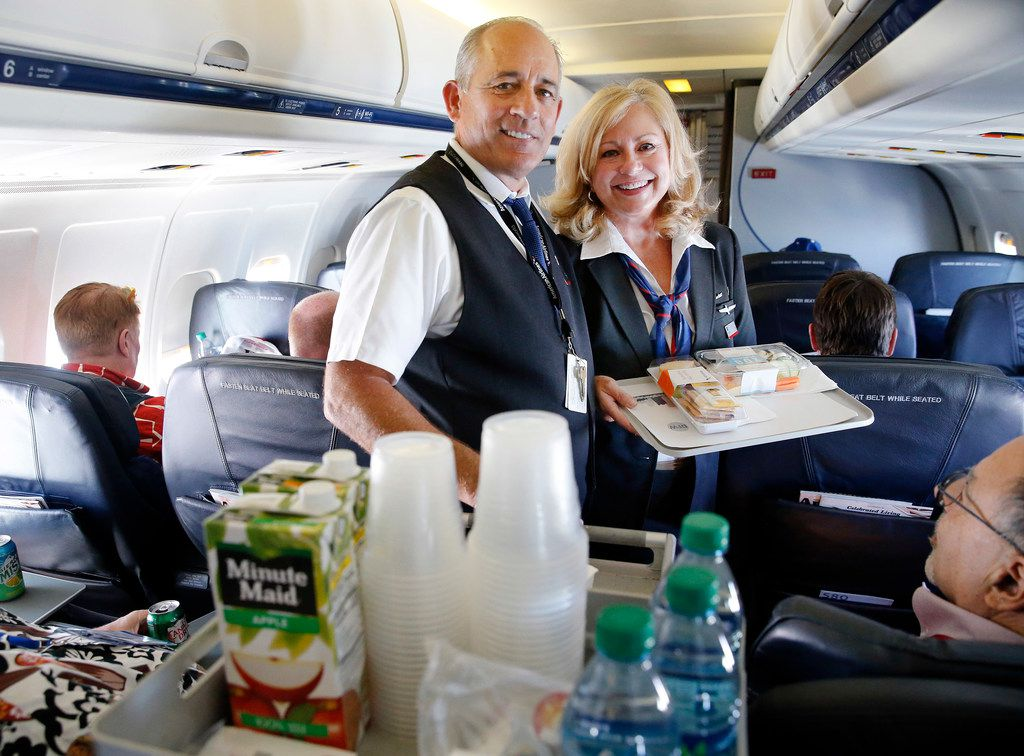 American Airlines flight attendants Jeff and Valerie Ricci of Grand Prairie met while working on an MD-80 before marrying 30 years ago.  They were serving passengers on their final MD-80 ferry flight to Roswell.