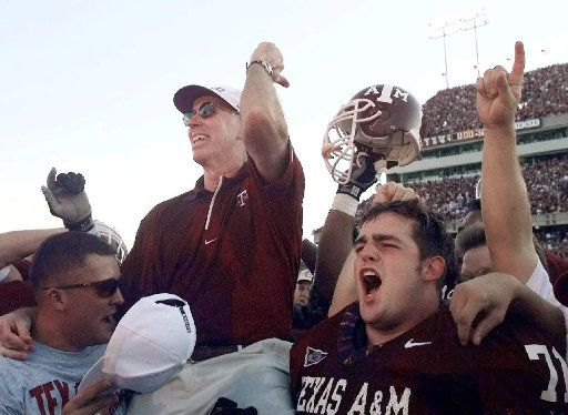 Texas A&M coach R.C. Slocum is lifted to the shoulders of his players after they defeated second-ranked Nebraska in College Station, Texas, Saturday, Oct. 10, 1998. Texas A&M won 28-21.