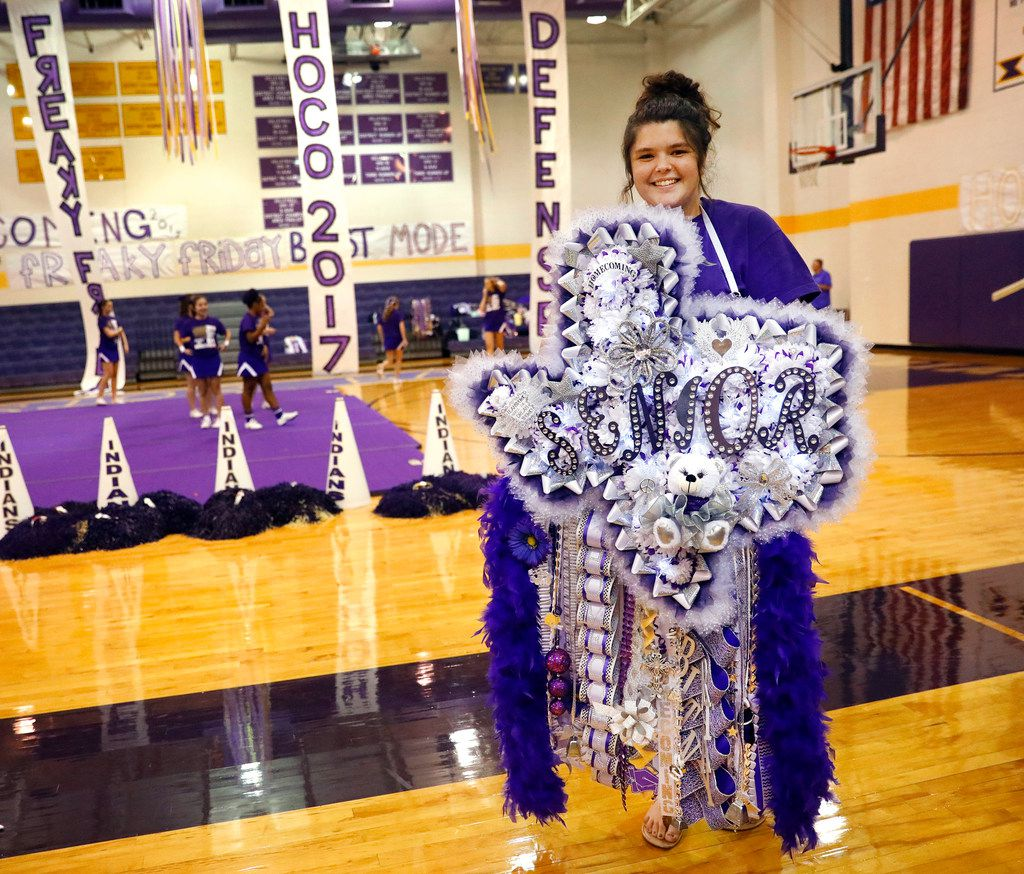 Alvarado High senior Brittany Eicker wore a 'Texas-sized' mum  to their homecoming pep rally, complete with artificial flowers, ribbons, trinkets and teddy bear.