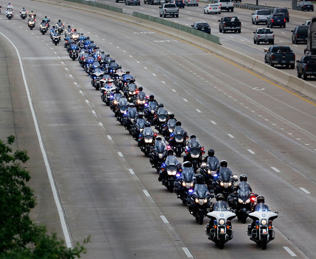 Dallas police officers lead the funeral procession for Dallas Police Officer Rogelio Santander on North Central Expressway and Galatyn Parkway in Richardson, Texas, on Tuesday, May 1, 2018. Santander was shot and killed a week earlier while trying to arrest a man at a Home Depot.