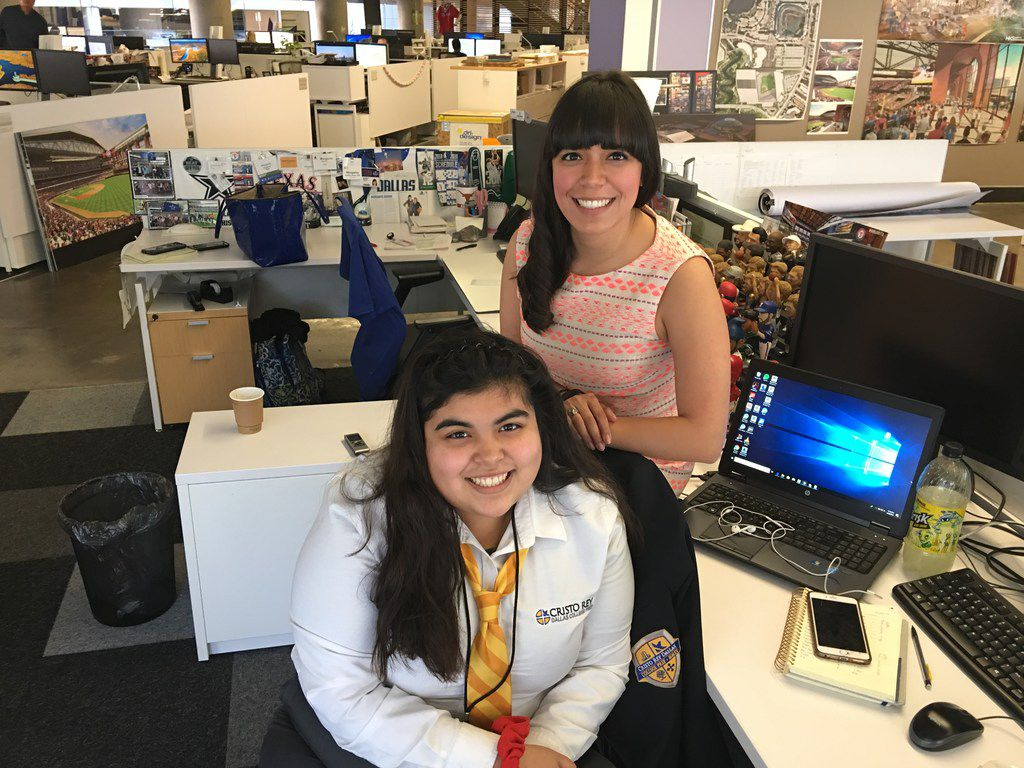 Carla Cano (left) with Margarita Aguirre at the downtown HKS headquarters. Cano is a Cristo Rey Dallas College Prep student being mentored by Aguirre.