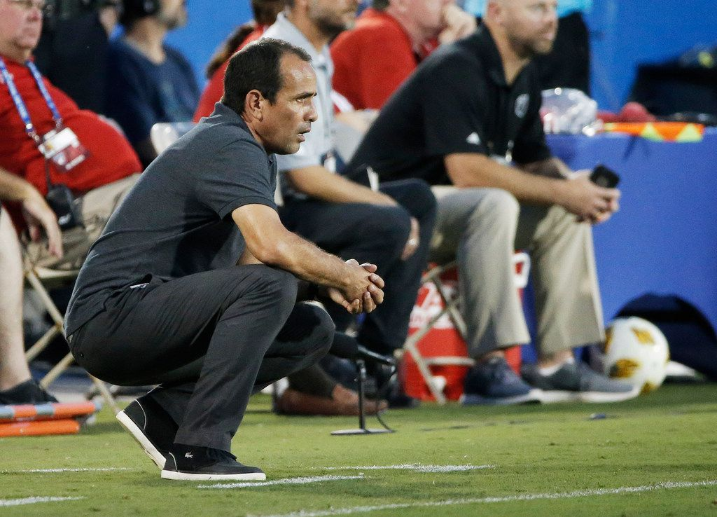 FC Dallas head coach Oscar Pareja looks on from the sidelines during the first half of an MLS soccer match against the Columbus Crew, Saturday, Sept. 15, 2018, in Frisco, Texas. The game ended 0-0. (AP Photo/Brandon Wade)
