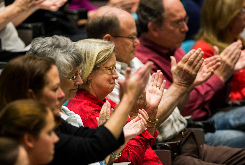 Plano citizens applaud as Plano City Council member Tom Harrison defends his post on social media about banning Islam in public schools in a hearing on Monday, April 23, 2018 at Plano City Hall. The council is considering a recall of the November 6 election.