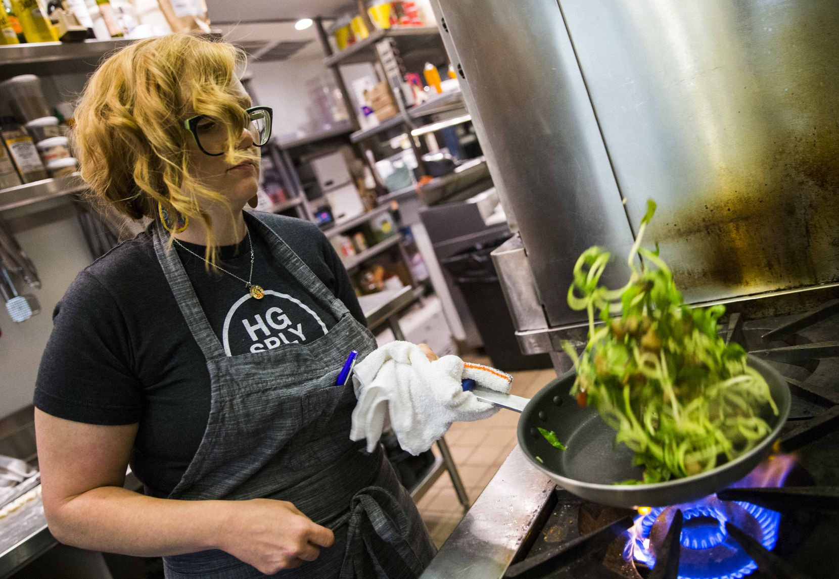 Chef Danyele McPherson makes a zucchini pasta bowl from spiraled zucchini on Thursday, March 31, 2016 at Remedy restaurant in Dallas. (Ashley Landis/The Dallas Morning News)
