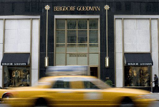 A taxi cab drives past the Bergdorf Goodman store in New York City. (Photo by Stephen Chernin/Getty Images for the Dallas Morning News)