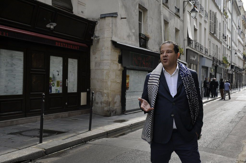 """Gentrification can also mean new life for completely dormant neighborhoods. Cedric Naudon, the real estate developer behind the """"La Jeune Rue"""" project, in the Haut Marais neighborhood of Paris, in 2014. Naudon envisions organic bakeries, oyster bars, ethnic restaurants and other foodie destinations in this quiet neighborhood. """"It's empty now, but when all this opens, it will be completely unique,"""" says Naudon. (Capucine Granier-Deferre/The New York Times)"""