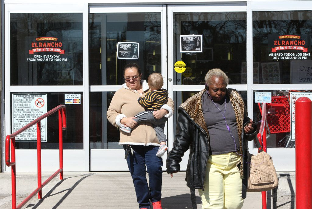 """Edna Herod, left, and Jackie Darby, right, walks away after reading a sign, in English and Spanish, on the door of Supermercado El Rancho, on 4121 Gaston Ave, in Dallas, that informed them that the store would be closed on Thursday, 2/16/17 in support of the """"Day Without Immigrants"""" protest. Across Dallas, the state, and nation, shops and restaurants closed in solidarity on Thursday for a """"Day Without Immigrants. (Irwin Thompson/The Dallas Morning News)"""