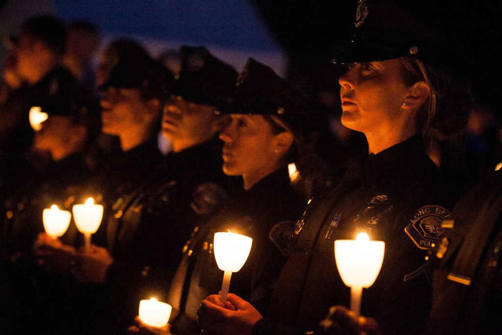 Law enforcement officers hold candles during a candlelight vigil on the National Mall Saturday, May 13, 2017 in Washington, D.C.  The 29th annual vigil took place during National Police Week and honored law enforcement officers who have fallen in the line of duty.  (Zach Gibson/Special Contributor)