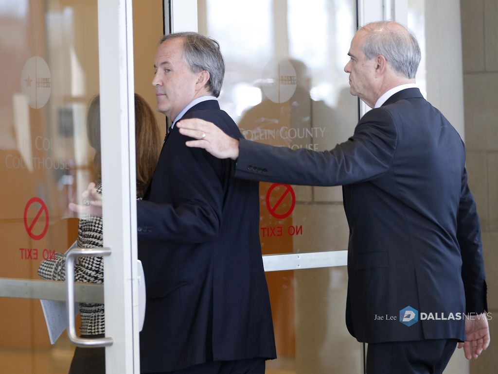 Texas Attorney General Ken Paxton (left) and his attorney Phillip Hilder enter the Collin County Courthouse for his pretrial hearing in McKinney, Texas, Thursday, Feb. 16, 2017. (Jae S. Lee/The Dallas Morning News)