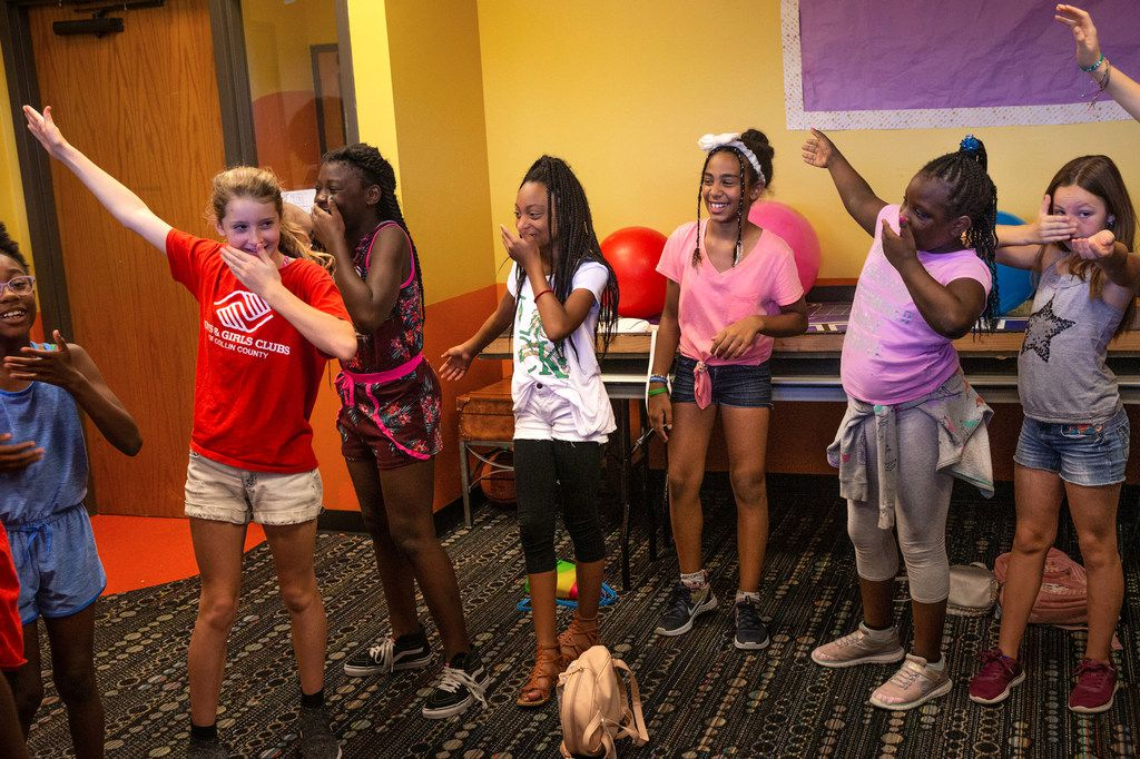 Children participate in a warm-up exercise during a theatre class presented by Humanities of Tomorrow at the Boys and Girls Club of Collin County in Frisco on Wednesday, July 31, 2019. The Humanities of Tomorrow program was founded by high school students to offer an arts and humanities curriculum to children during one-week programs.