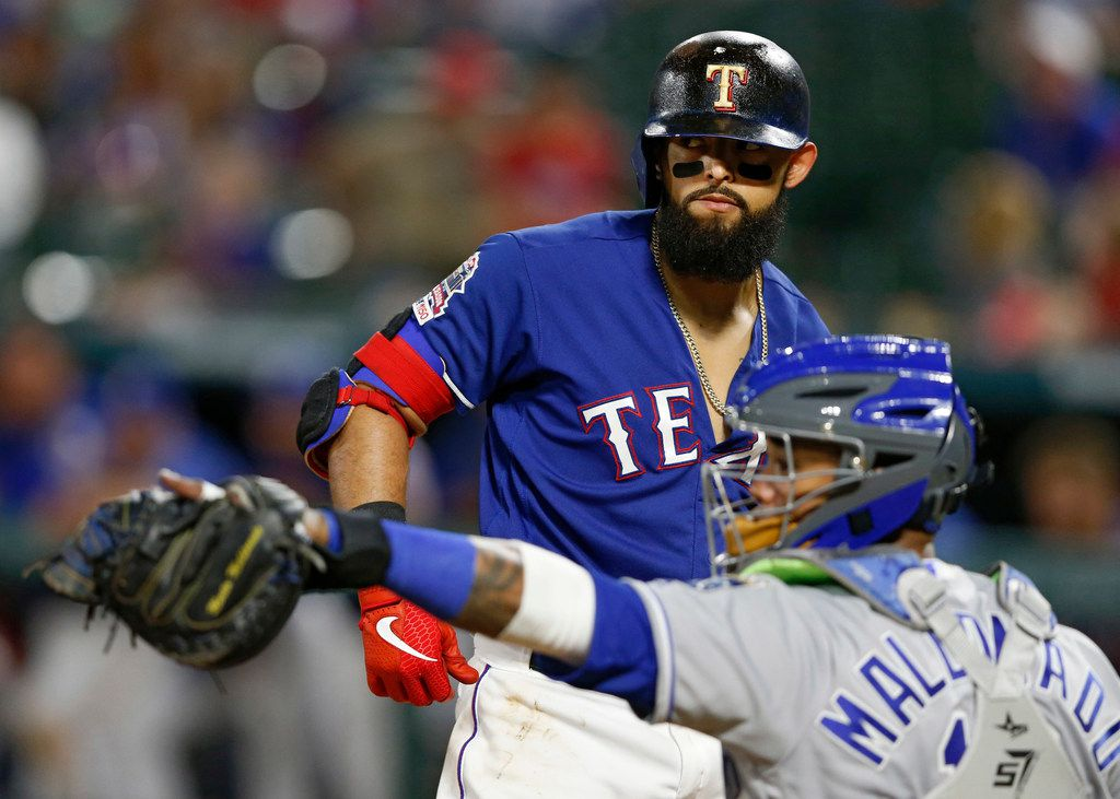 Texas Rangers second baseman Rougned Odor (12) looks back as Kansas City Royals catcher Martin Maldonado (16) throws the ball back after Odor was struck out on the last out of the game at Globe Life Park in Arlington, Texas on Thursday, May 30, 2019. Texas Rangers lost to the Kansas City Royals 4-2. (Vernon Bryant/The Dallas Morning News)