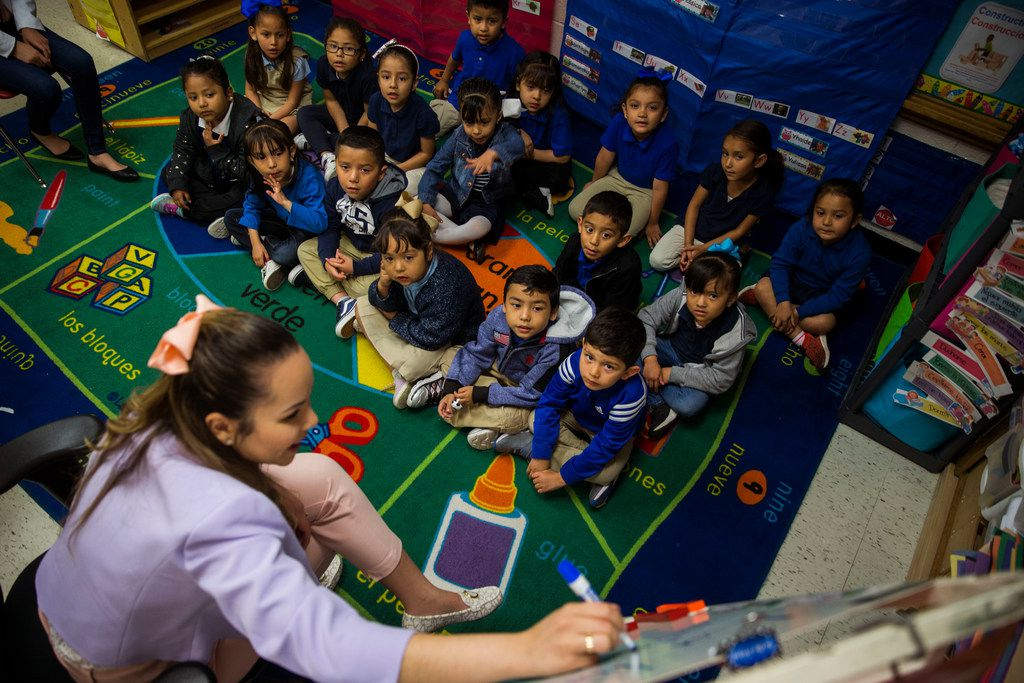 Pre-K teacher Rosa Yabur leads students through a reading exercise during class at B. H. Macon Elementary in Dallas on March 29, 2019. Yabur teaches both Spanish and English to the children.
