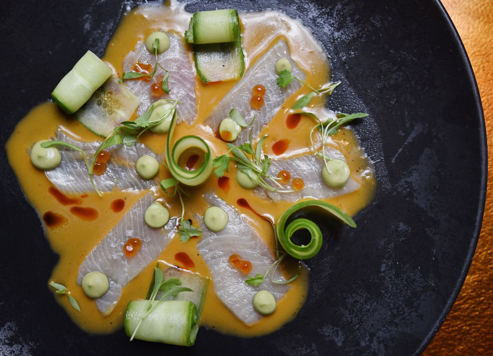 Yellowtail tiradito with rocoto, avocado and cucumber