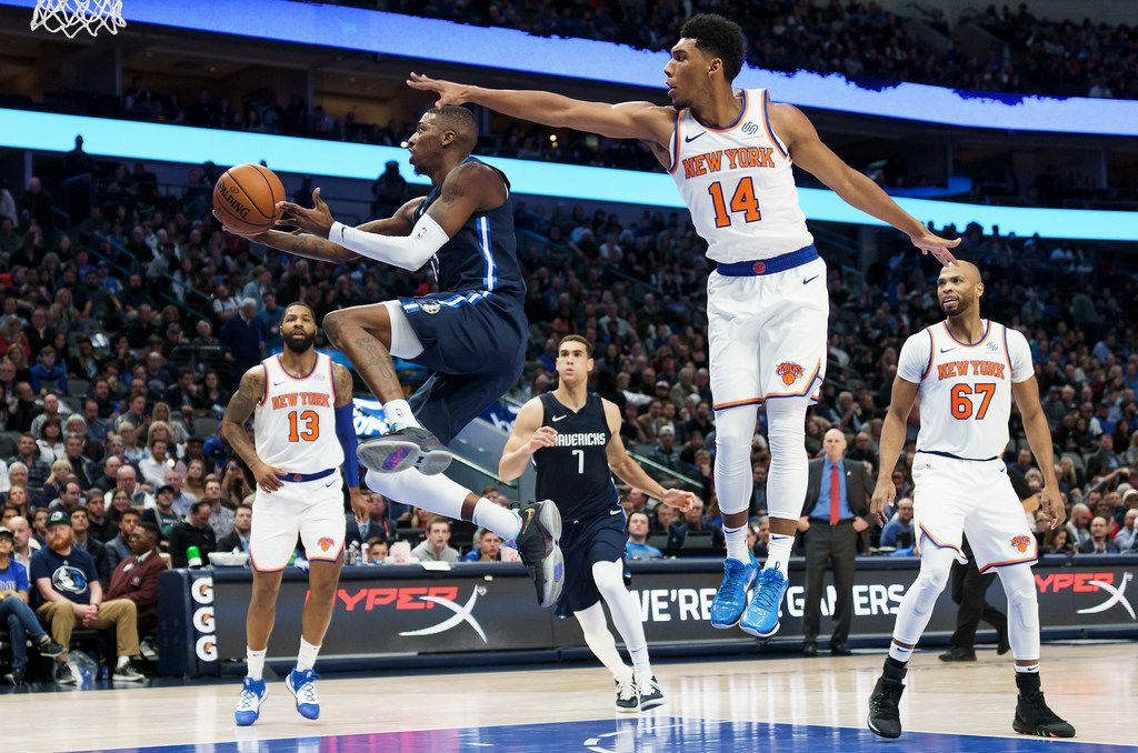 Dallas Mavericks guard Delon Wright (55) drives to the basket past New York Knicks guard Allonzo Trier (14) during the first half of an NBA basketball game at American Airlines Center on Friday, Nov. 8, 2019, in Dallas. (Smiley N. Pool/The Dallas Morning News)