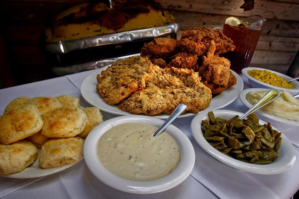 A family-style portion of chicken-fried steak and fried chicken is pictured with a plate of biscuits, gravy, green beans and corn at Babe's Chicken Dinner House. A new location will open in October 2018 in North Richland Hills.