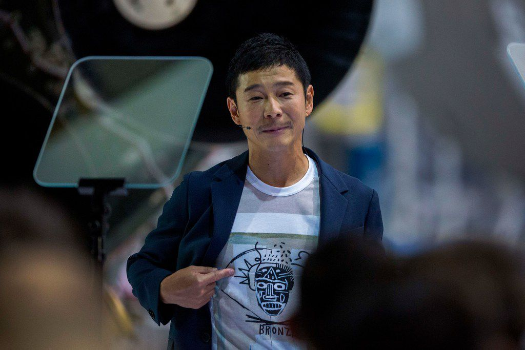 Japanese billionaire Yusaku Maezawa wears a shirt depicting the work of one of his favorite artists during the announcement by Elon Musk that he will be the first private passenger who will fly around the Moon aboard the SpaceX BFR launch vehicle, at the SpaceX headquarters and rocket factory on September 17, 2018 in Hawthorne, California. - Japanese billionaire businessman, online fashion tycoon and art collector Yusaku Maezawa was revealed as the first tourist who will fly on a SpaceX rocket around the Moon. (Photo by DAVID MCNEW / AFP)DAVID MCNEW/AFP/Getty Images