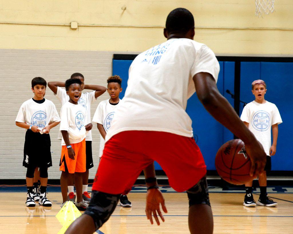 Campers react to NBA Dallas Maverick forward, Harrison Barnes teaching ball handeling skills during the Harrison Barnes Basketball Camp in Dallas, Saturday, June 10, 2017. (Tailyr Irvine/The Dallas Morning News)