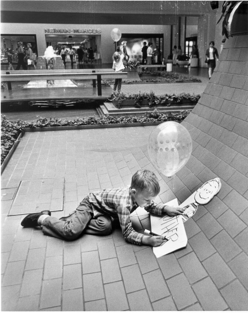 Children gravitated to the planter box in front of Neiman Marcus from day one at NorthPark Center. Lots of promotional photos were taken of real people on Aug. 19, 1965. This unidentified boy was used in directories and brochures into the 1970s. Back then, names weren't always included with photos.