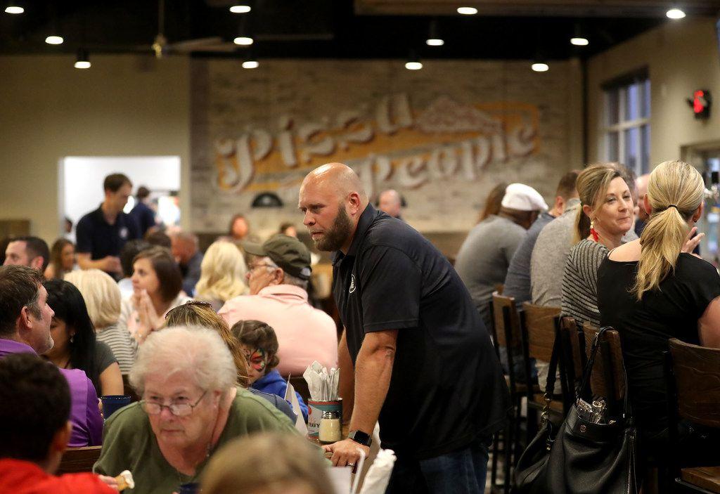 Owner Barian McGuire talks to diners during the 'friends and family' dinner at the new restaurant, Rotolo's Craft & Crust, in Frisco, Texas Saturday, Sept. 29, 2018. (Anja Schlein/Special Contributor)