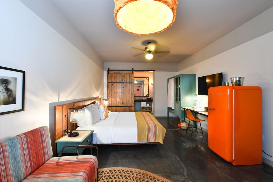 Every room at Texican Court, a new hotel in Las Colinas, has an orange Smeg fridge.