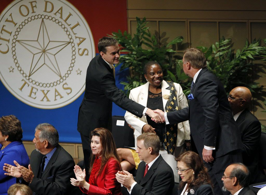 Newly sworn-in Dallas council members Scott Griggs (left) and Rick Callahan congratulated each other during an inaugural ceremony at the Morton H. Meyerson Symphony Center in June 2013.