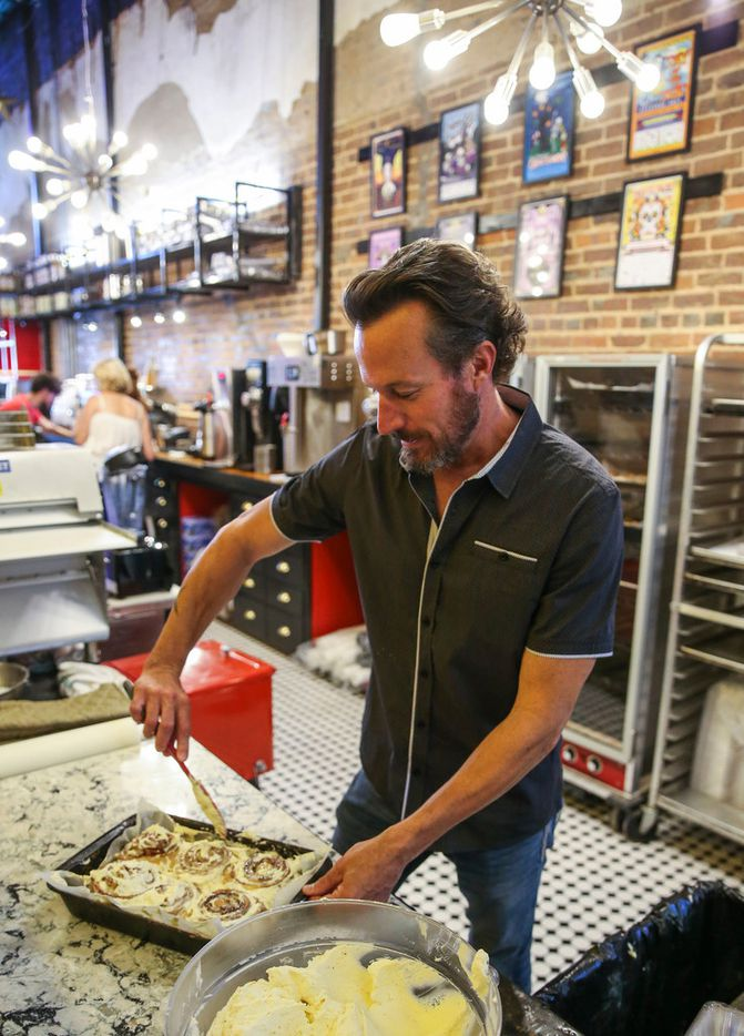 Jupiter House co-owner Joey Hawkins ices cinnamon rolls on Thursday, May 16, 2019 at Jupiter House coffee shop in Denton, Texas. (Ryan Michalesko/The Dallas Morning News)