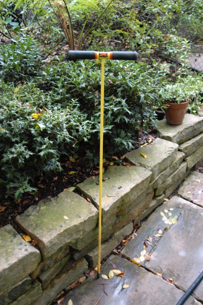A pipe probe measures soil moisture.