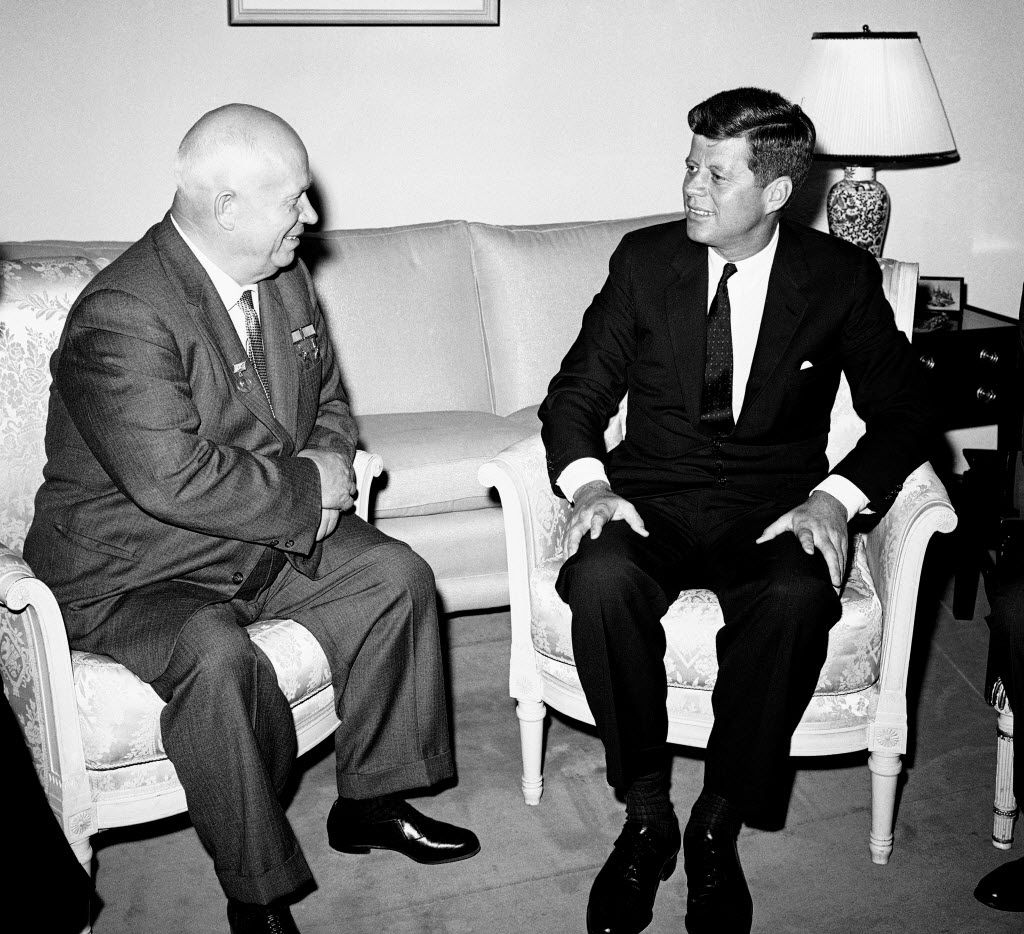 FILE - In this June 3, 1961, file photo, Soviet Premier Nikita Khrushchev and President John F. Kennedy talk in the residence of the U.S. Ambassador in a suburb of Vienna.