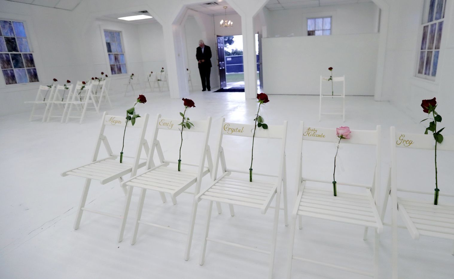 A memorial for the victims of the shooting at Sutherland Springs First Baptist Church, including 26 white chairs each painted with a cross and and rose, is displayed in the church Sunday, Nov. 12, 2017, in Sutherland Springs, Texas. A man opened fire inside the church in the small South Texas community last week, killing more than two dozen.