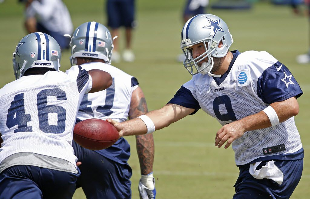 Dallas Cowboys quarterback Tony Romo (9) hands the ball to running back Alfred Morris (46) during a minicamp at Valley Ranch on Wednesday, June 15, 2016, in Irving, Texas. (Jae S. Lee/The Dallas Morning News)