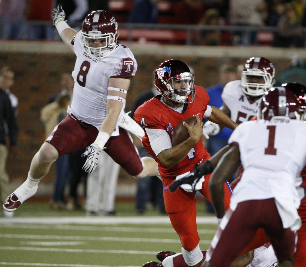 Temple Owls linebacker Tyler Matakevich (8) tries to catch Southern Methodist Mustangs quarterback Matt Davis (4) in a long run in the second quarter  against the Temple Owls at Gerald J. Ford Stadium on November 6, 2015 in Dallas, Texas.   (Nathan Hunsinger The Dallas Morning News)