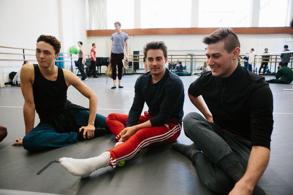 Booker T. Washington alumni Kade Cummings, 19, (left), Zane Unger, 18, and Todd Baker, 19, (right) warm up before first year ballet class at The Julliard School. (Cassandra Giraldo/Special Contributor)