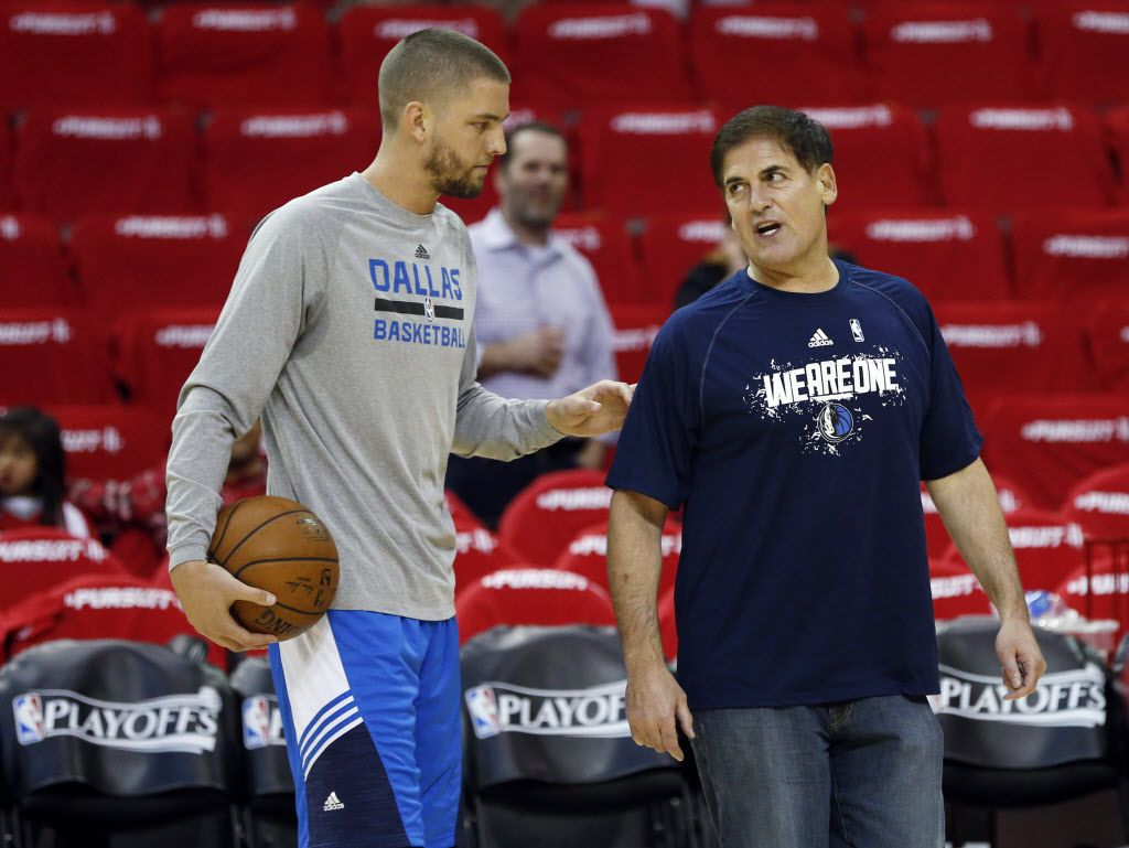 Dallas Mavericks forward Chandler Parsons (25) and Dallas Mavericks owner Mark Cuban talk before game 1 against the Houston Rockets in the first round of the NBA playoffs at Toyota Center in Houston on Saturday, April 18, 2015. (Vernon Bryant/The Dallas Morning News)