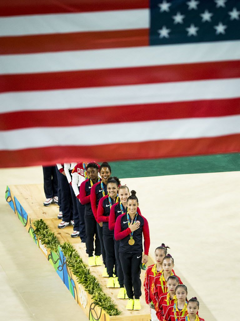 The USA gymnastics team after they won the gold medal in the women's team gymnastics final at the Rio 2016 Olympic Games. (Smiley N. Pool/The Dallas Morning News)