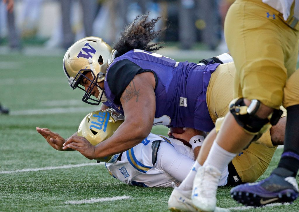 FILE - In this Oct. 28, 2017, file photo, Washington's Vita Vea sacks UCLA quarterback Josh Rosen in the first half of an NCAA college football game, in Seattle. Vea's impact on the game was enough that coaches voted the Washington defensive tackle the Pac-12 Defensive Player of the Year. (AP Photo/Elaine Thompson, File)