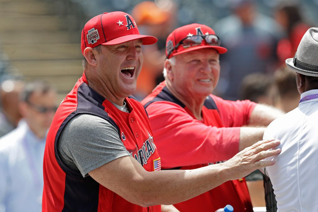 American League manager Jim Thome laughs as players take batting practice for the MLB All-Star Futures baseball game, Sunday, July 7, 2019, in Cleveland. The 90th MLB baseball All-Star Game will be played Tuesday. (AP Photo/Tony Dejak)