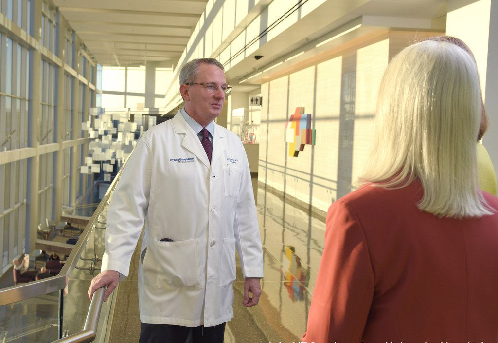 Dr. John Warner has a unique survival story after having a cardiac arrest at a medical convention last year.