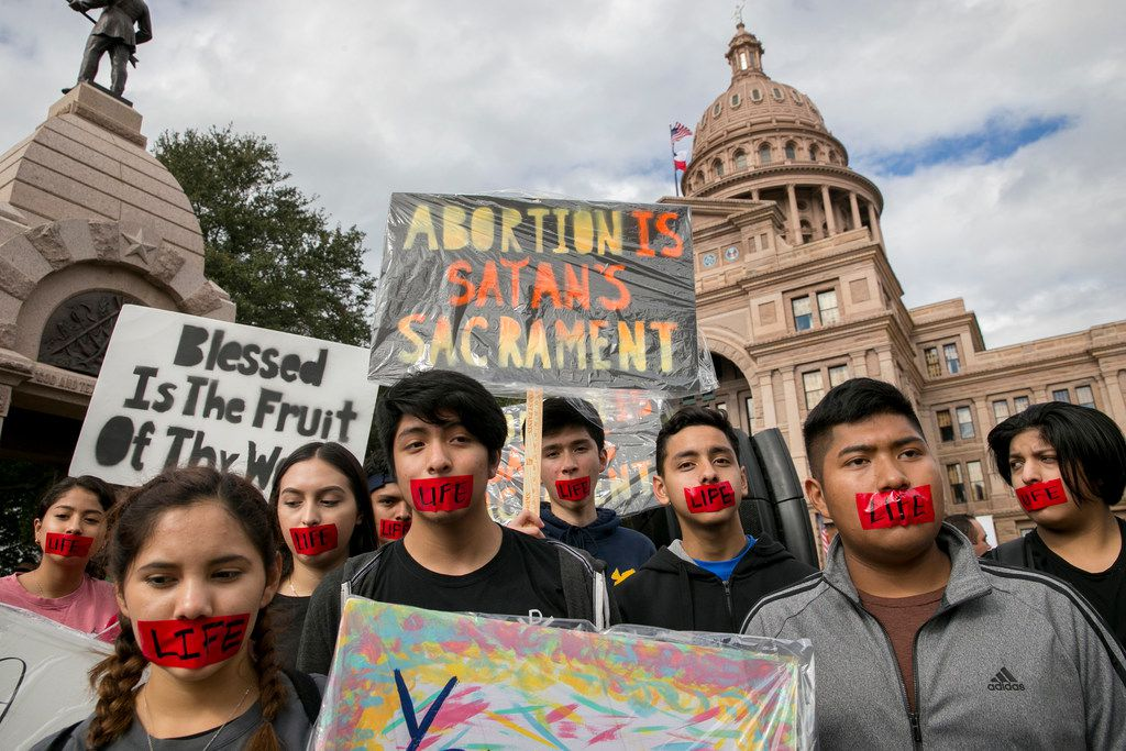 Youth members of Notre Dame Catholic Church in Houston, left to right, Abi Rosales, 15, Karen Barajas, 19, Dilsia Benitez, 17, Joel Pacheco, 16, Rivaldo Perez, 16, Jeroboam Hernandez, 15, Jose Gomez, 16, and Jonhatan (CQ) Penaloza, 14, participate in the Texas Rally for Life at the Capitol in Austin, Texas, on Saturday, Jan. 27, 2018. Thousands marched through downtown and gathered at the south steps of the Capitol for the rally. (Jay Janner/Austin American-Statesman)