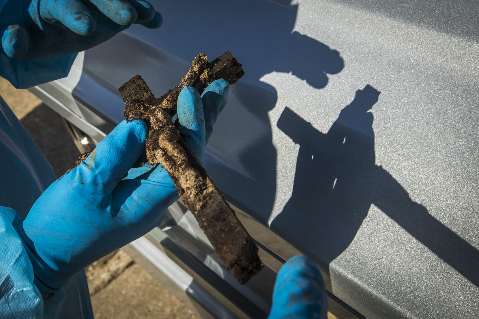 Funeral director Chris Taylor found this crucifix still intact inside the casket of the Rev. Damian Szodenyi, who was buried with it in 1998.