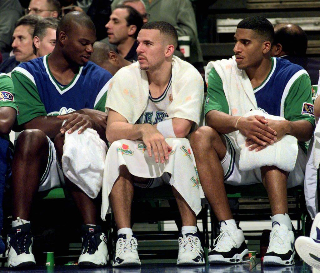 In eleven days on the job as the new Dallas Mavericks general manager, Don Nelson, sent the team's starting lineup to the New Jersey Nets, Monday night, Feb. 17, 1997, in what is believed to be the largest trade between two NBA teams in the last 25 years. Guard Jim Jackson, right, is one of five players sent to New Jersey. Nelson traded forward Jamal Mashburn, left, to Miami on Friday. Guard Jason Kidd, center, was traded to Phoenix in December. Mashburn, Kidd and Jackson sit on the bench in a game in Dallas in this Nov. 12, 1996, file photo.
