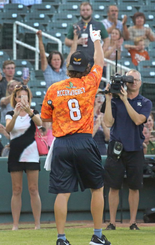 Actor Matthew McConaughey acknowledges the cheers of the crowd after the Red River celebrity softball game home run contest at the Dr. Pepper Ballpark in Frisco, Texas. (Louis DeLuca/The Dallas Morning News)