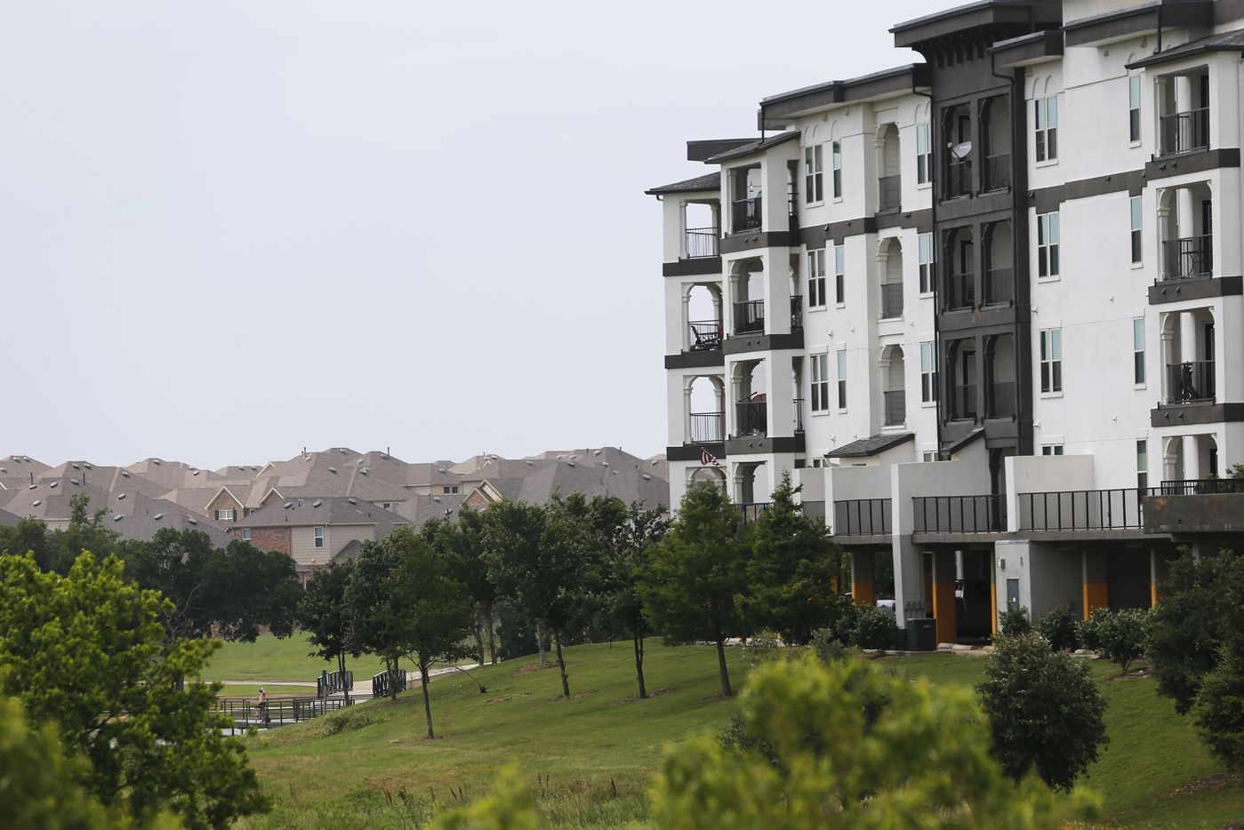 Overlook By The Park apartment complex at the border of Frisco and Little Elm off of FM 423 is seen on the right next to a park and homes in the distance in Little Elm, Texas on Wednesday, May 22, 2019. Little Elm, which had just 3,500 people as of the 2000 Census, surpassed 50,000 residents in 2018. (Vernon Bryant/The Dallas Morning News)