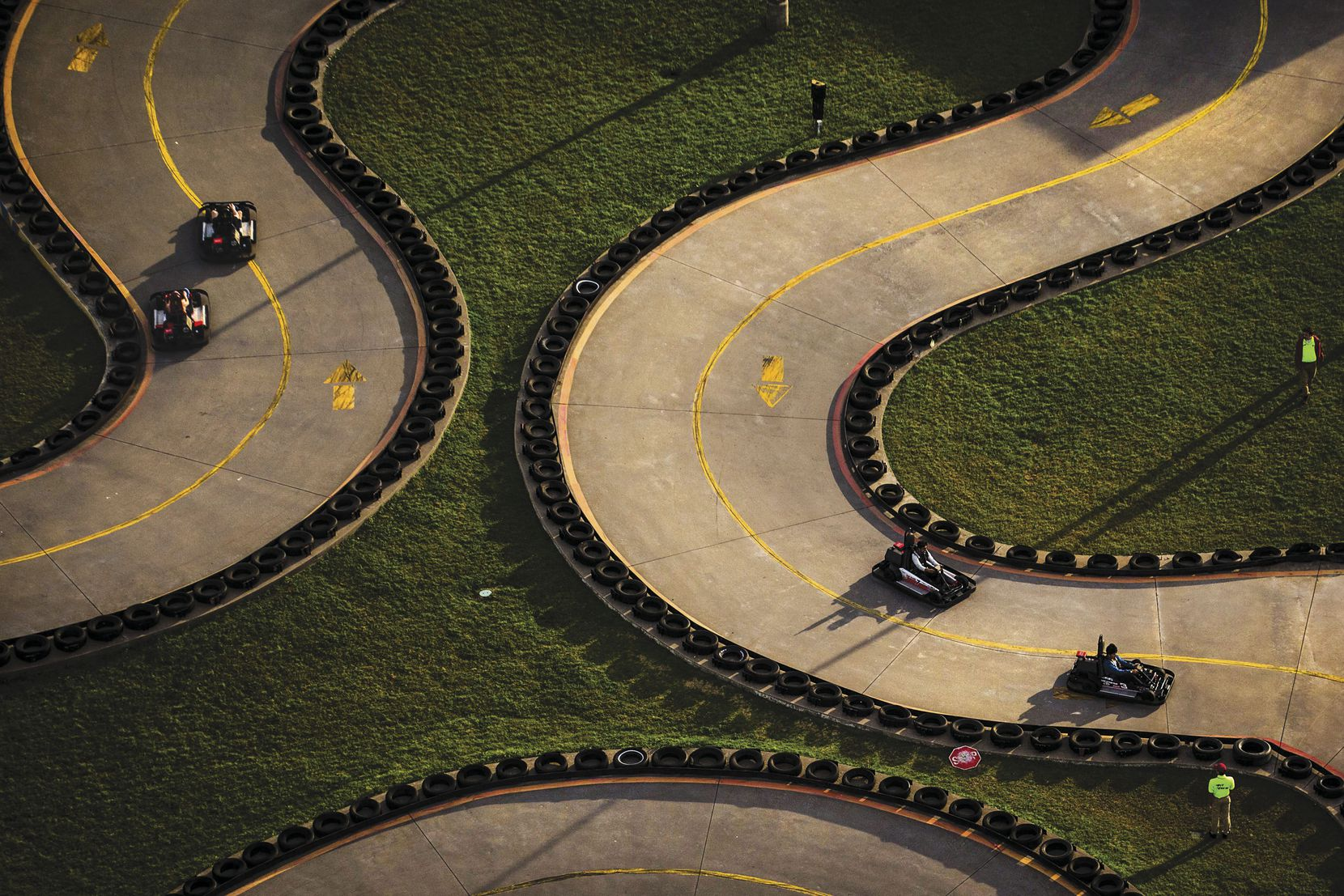 Go-kart drivers zip around the track at Zone Action Park in Lewisville.