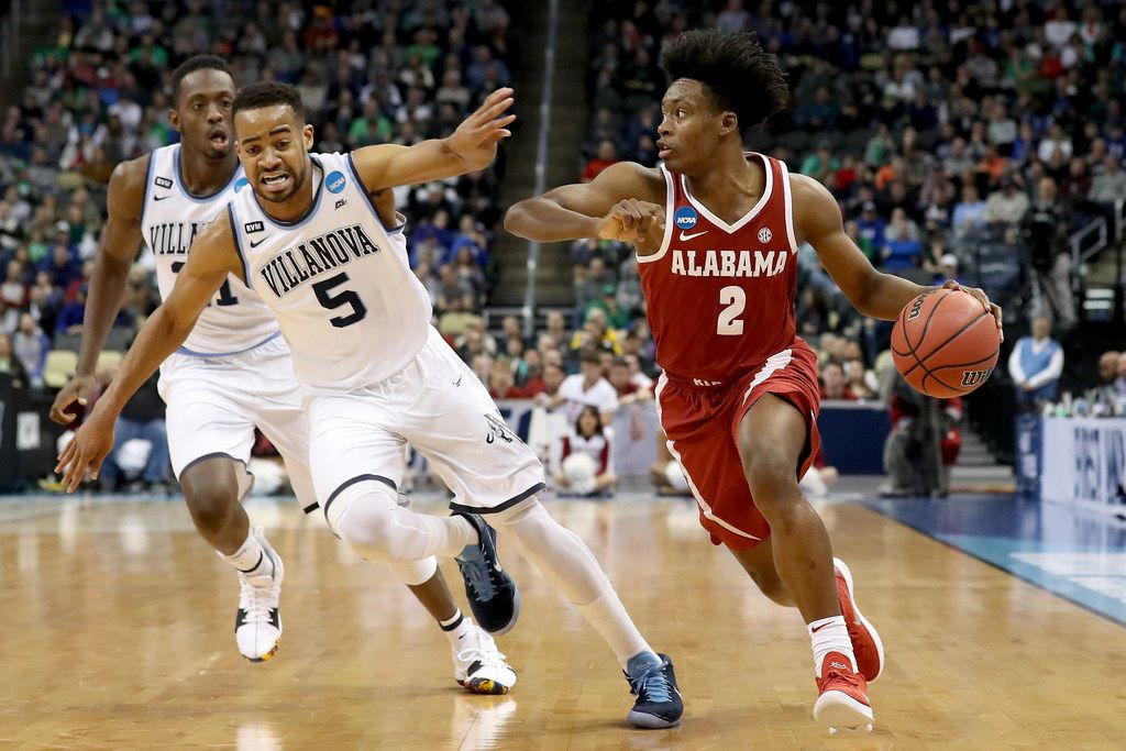 PITTSBURGH, PA - MARCH 17:  Collin Sexton #2 of the Alabama Crimson Tide dribbles against Phil Booth #5 of the Villanova Wildcats during the first half in the second round of the 2018 NCAA Men's Basketball Tournament at PPG PAINTS Arena on March 17, 2018 in Pittsburgh, Pennsylvania.  (Photo by Rob Carr/Getty Images)