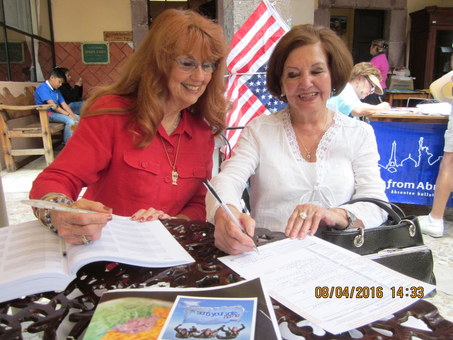 Judith Turner, a volunteer with Democrats Abroad in Mexico, helps a resident in San Miguel de Allende register to vote.