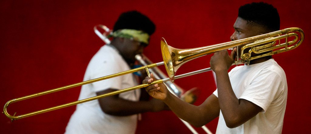 Trombone players warm up before practice for the Dallas Mass Band.